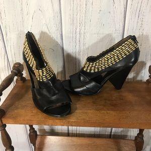 Black & Gold Carlos Santana Heels